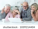 senior couples using laptop | Shutterstock . vector #1039214404