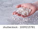 sea salt crystals in women hand ...   Shutterstock . vector #1039215781