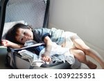 1 year old baby boy sitting on... | Shutterstock . vector #1039225351