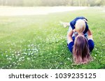 mother and child laughing and... | Shutterstock . vector #1039235125