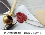 Small photo of Fountain pen and old notarial wax seal on document, closeup
