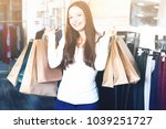 portrait of glad woman standing ... | Shutterstock . vector #1039251727