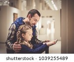 young father and daughter... | Shutterstock . vector #1039255489