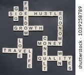 Small photo of Letters forming Side Hustle and Entrepreneurial words in a cross word style to be used in side hustle gig concepts