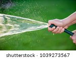 woman hand holding rubber water ... | Shutterstock . vector #1039273567