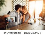 young attractive couple taking... | Shutterstock . vector #1039282477