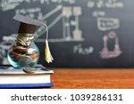 hat graduation model on coins... | Shutterstock . vector #1039286131