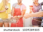 group of happy friends cooking... | Shutterstock . vector #1039289305