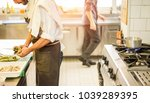 chef cutting artichokes for... | Shutterstock . vector #1039289395