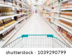 empty shopping cart with... | Shutterstock . vector #1039290799