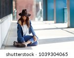 young woman sprained her legs.... | Shutterstock . vector #1039304065