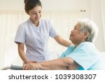 cheerful asian nurse visiting... | Shutterstock . vector #1039308307