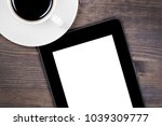 digital tablet and coffee cup... | Shutterstock . vector #1039309777