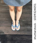 blue shoes isolated on wood... | Shutterstock . vector #1039324051