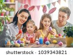 mother  father and daughters... | Shutterstock . vector #1039343821