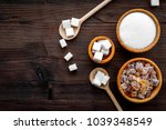 Small photo of Sugar types. Cane, refind, granulated, cubes, candy sugar. Dark wooden background top view copy space