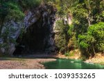 at the end of the cave outside... | Shutterstock . vector #1039353265