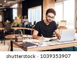 freelancer bearded man in t... | Shutterstock . vector #1039353907