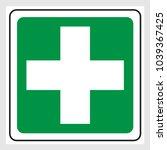 first aid cross sign. green...   Shutterstock .eps vector #1039367425