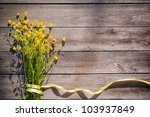 Yellow Flowers On Wooden...
