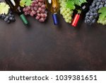 wine bottles and grapes on... | Shutterstock . vector #1039381651