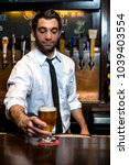 a male bartender pouring and... | Shutterstock . vector #1039403554