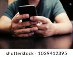 cropped view of male hands... | Shutterstock . vector #1039412395