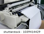 continuous paper printer in the ... | Shutterstock . vector #1039414429