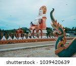 statues of sitting laughing... | Shutterstock . vector #1039420639
