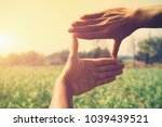 hand framing view distant over... | Shutterstock . vector #1039439521