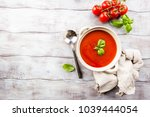 tomato soup on wooden table | Shutterstock . vector #1039444054