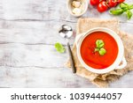 tomato soup on wooden table   Shutterstock . vector #1039444057