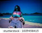 the image of the beach is... | Shutterstock . vector #1039458415