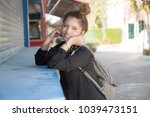 the girl in the street store... | Shutterstock . vector #1039473151