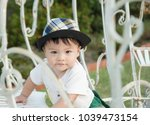 thai boy with the hat in the... | Shutterstock . vector #1039473154