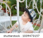 thai boy with the hat in the... | Shutterstock . vector #1039473157