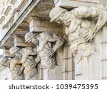 statues of the atlases holding... | Shutterstock . vector #1039475395