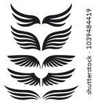 black silhouette wings emblem... | Shutterstock .eps vector #1039484419