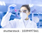 female scientist looking at the ... | Shutterstock . vector #1039497361