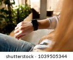 the modern smart watch on the... | Shutterstock . vector #1039505344