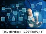 businessman press virtual screen | Shutterstock . vector #1039509145
