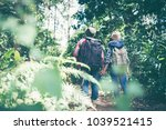couple travelers with backpacks ... | Shutterstock . vector #1039521415