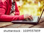 female student typing on laptop ... | Shutterstock . vector #1039557859