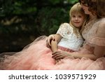 mom and daughter. mother's... | Shutterstock . vector #1039571929