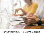 start up partners are working... | Shutterstock . vector #1039575085