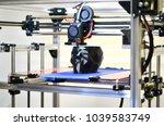 3d printer printing a model in... | Shutterstock . vector #1039583749