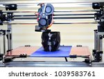 3d printer printing a model in... | Shutterstock . vector #1039583761
