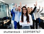 successful team of young... | Shutterstock . vector #1039589767