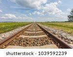 railroad track in open... | Shutterstock . vector #1039592239