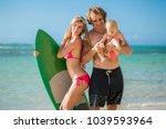family having fun surfing... | Shutterstock . vector #1039593964